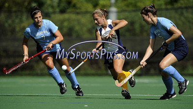 Columbia University's Katie DeSandis (7) and Julia Garrison (9) surround Quinnipiac University's Megan McCreedy (20) during a 3-2 Columbia win in Hamden, Conn., on Sunday, September 13, 2009. (photo by Mike Orazzi)