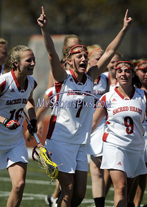 Sacred Heart University's Colleen Nassauer (7) celebrates the Pioneers 11-6 win over Quinnipiac in the NEC Championship title game in Fairfield on Sunday, April 26, 2009. photo by Mike Orazzi.