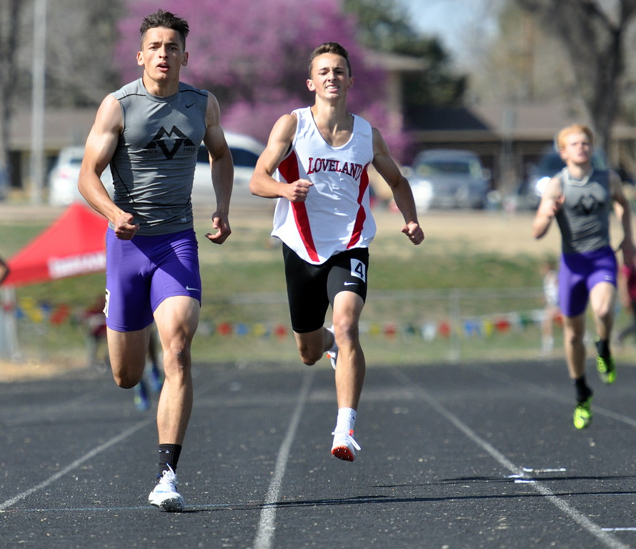 . Mountain View\'s Nolan Kembel, left, and Loveland\'s Adam Stark grind out the finish of the 400-meter run Thursday April 13, 2017 during the R2J Invite in Loveland. Kembel won with a district-record time of 47.87. (Cris Tiller / Loveland Reporter-Herald)