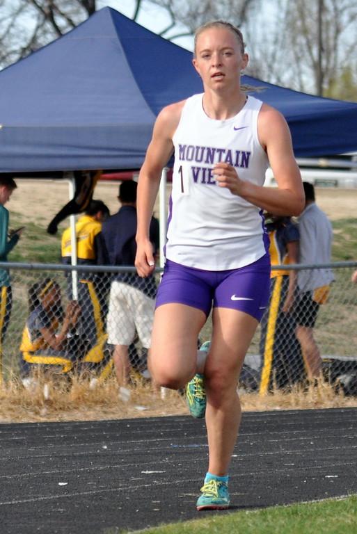 . Mountain View\'s Lauren Offerman rounds the corner of the 3,200-meter run Thursday April 13, 2017 during the R2J Invite in Loveland. (Cris Tiller / Loveland Reporter-Herald)