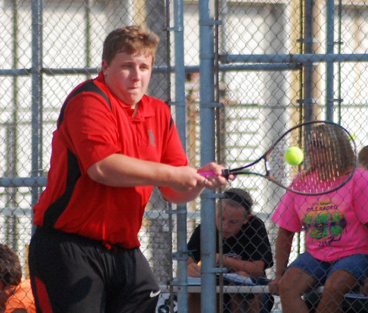 Aaron Kirchoff/Rushville Republican<br /> Rushville's Adam Martin hits a backhand return during action at No. 2 doubles in the season opener against East Central.