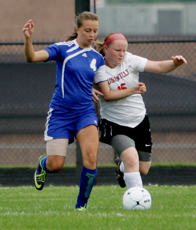 Kate Thurston/Rushville Republican<br /> Rushville's Alisha Markley battles for the ball in the Lady Lions' season opener.
