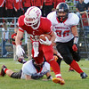 Aaron Kirchoff/Rushville Republican<br /> Rushville junior Hunter Barnett pursues Connersville runningback Colton Gonzalez during the Lions' victory at Connersville.