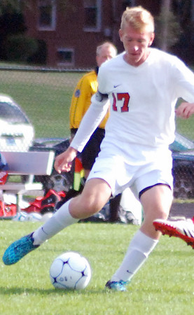 Aaron Kirchoff/Rushville Republican <br /> Rushville senior Luke Sheehan plays the ball forward for the Lions. Sheehan scored on a penalty kick for the Lions' lone goal in the sectional loss to New Castle.