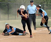 Bob Raines--Montgomery Media / North Penn's Bri Battavio screams in pain as Avon Grove's Alyssa Herion takes off for the plate after colliding with the third baseman May 22. 2015.