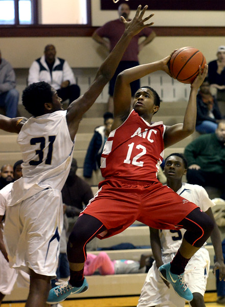 ANC's Tim Spencer shoots over Cheltenham's Jamil Bates.<br /> Bob Raines-Digital First Media