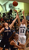 Bob Raines-- Montgomery Media<br /> North Penn's Taylor Thomas sends a shot over Spring-Ford's Sydney Wagnerl Feb. 23, 2015.