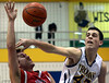 Bob Raines--Montgomery Media<br /> Wissahickon's Zach Reiner fouls Upper Dublin's Matt Thompson as he swats away the ball Tuesday, Feb. 3, 2015.