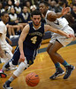 Bob Raines--Montgomery Media<br /> Wissahickon's Tre Holcomb drives for the basket past Cheltenham's Maurice Valentine Friday, Feb. 6, 2015.