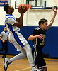 Bob Raines--Montgomery Media<br /> Phil-Mont's Osaze Thornton goes up for a shot past Friends Select's Jacob Taranta, Friday, Feb. 20, 2015.