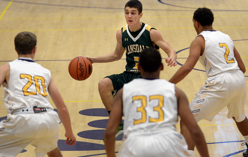 Lansdale Catholic's Nick Maloney pulls up short as Upper Moreland defenders converge on him Wednesday, Dec. 17, 2014.<br /> Bob Raines Digital First Media
