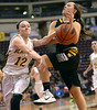 Bob Raines--Montgomery Media / Wood's Cassie Sebold gets fouled by Blackhawk's Breanna Hoover.