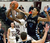 Bob Raines--Montgomery Media<br /> North Penn's Joey Richards fouls Abington's Amir Hinton as he shoots Friday, Feb. 13, 2015.