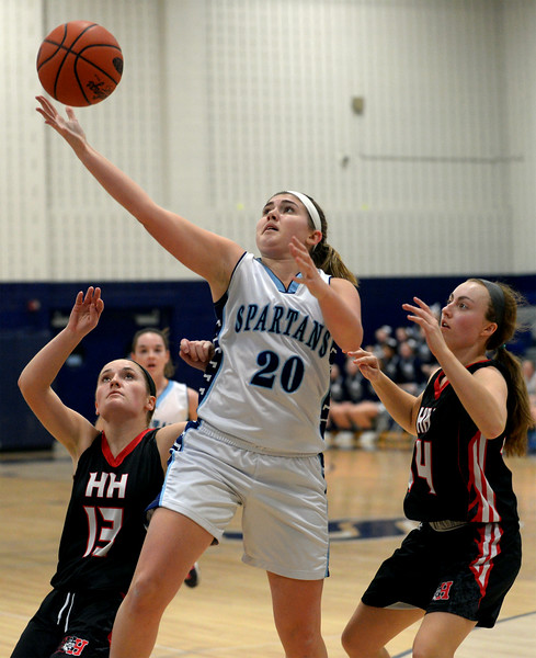 Springfield's Meg Smith stretches for a rebound heading out of bounds, beating out Hatboro Horsham palyers Bergen Sims and Julia Thornton Monday, Jan. 5, 2015.<br /> Bob Raines-Montgomery Media
