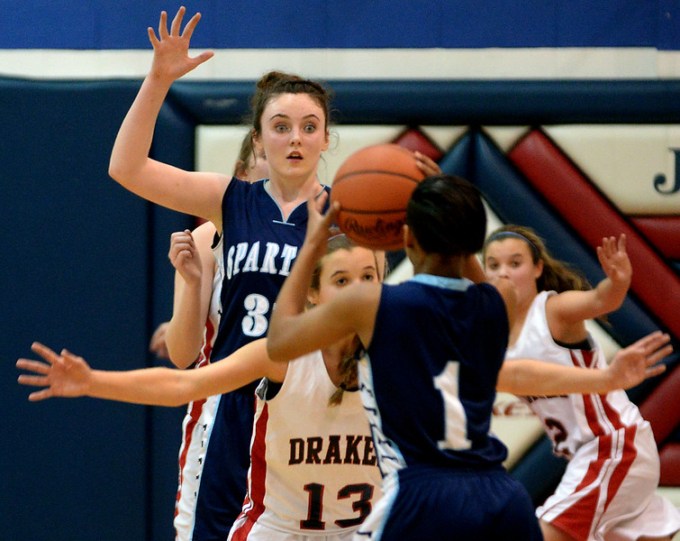 Springfield's Maura Ryan looks for a pass from Jayla Green Tuesday, Dec. 30, 2014.<br /> Bob Raines-Digital First Media