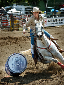Kelly Carr guides her horse past a barrel during her women's barrel racing performance at the Hamel Rodeo Saturday, July 12.  Carr and her horse completed the race in just over 14 seconds at Corcoran Lions Park.