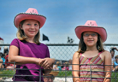 Delano cowgirls Alexis Klevann, 11, and her sister Paige, 7, pose inside the fence at the Hamel Rodeo Saturday matinee, July 10 in Hamel.