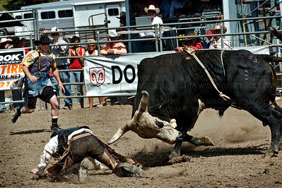 Sabeka, Minn. bull rider Jarem Gilbreath is about to be gored by the beast that threw him unless a rodeo clown, left, can distract the animal in time to save the rider.  Action at the Hamel Rodeo on Saturday, July 12 was exciting for all and nerve-wracking for some.