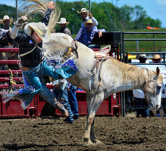 Kash Koester gets a leg up during his steer wrestling run Saturday, July 5, at the Hamel Rodeo in Corcoran.  Koester, a professional steer wrestling champion finished in 5.28 seconds.