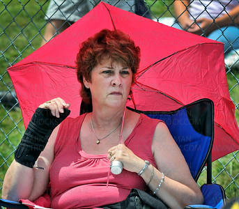 Umbrellas were used by many Hamel Rodeo audience members to keep the Sun at bay until the sky opened up and rain fell in a great torrent for several minutes during the Saturday matinee, July 10, in Hamel.