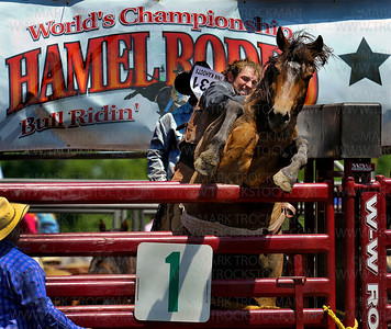 Monty Goodwin, Weatherford, OK, rides bareback for eight seconds and earns a score of 76 Saturday, July 7, at the Hamel Rodeo at Corcoran Lion's Park.