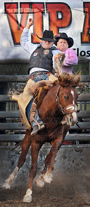 A pro rodeo cowboy gets taken for a ride in the Saddle Bronc Riding competition Thursday, July 7, during the Hamel Rodeo at Corcoran Lions Park.  The 31st annual Hamel Rodeo and Bull Riding Bonanza stampeded into town with 399 cowboys and cowgirls, hundreds of volunteers and thousands of fans during the popular four day event.