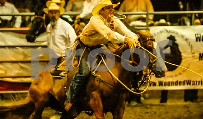 Calf Roper throws his lasso out at a calf