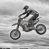 Ryan, (one of the three other Ryans) descending from a magnificent leap, fun at the RPM Supermoto Races in Abbotsford, BC. Photo modified in PS5 with fun help from Topaz Filters.