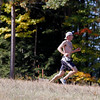 Record-Eagle/Jan-Michael Stump<br /> Saturday's King of the Mountain winner Trevor Darnell (101) runs down Mt. Holiday near the end of the three mile obstacle-filled course.