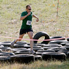Record-Eagle/Jan-Michael Stump<br /> Rob Garrow, Jr. (109) runs through tires on Mt. Holiday on the three mile obstacle-filled course of Saturday's King of the Mountain race.