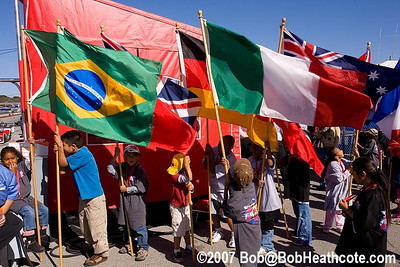 Children carried flags representing the nations of the competitors