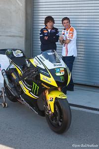 Honda crew enjoy watching the scrum for Rossi