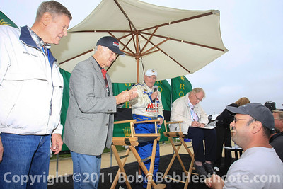 Dan Gurney honored (seated) with Bobby Unser and Bob Bondurant at Rolex Monterey Monterey Reunion 2010