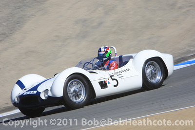 Dan Gurney honored, Dario Franchitti driving a Birdcage Maserati that Gurney once raced. Rolex Monterey Monterey Reunion 2010