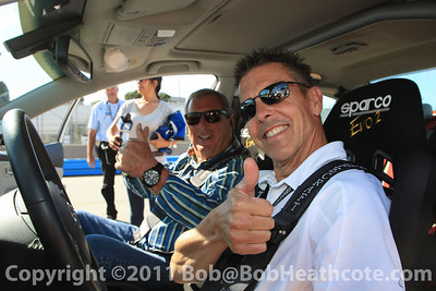 Fuzzy Zoeller and Scott Pruett about to go for a couple hot laps