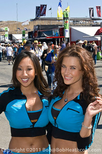 Mazda Raceway girls giving out free gifts to fans during the 2011 ModSpace American Le Mans Monterey presented by Patrón