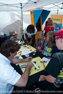 Young fans making solar-powered cars at the PG&E tent in the midway