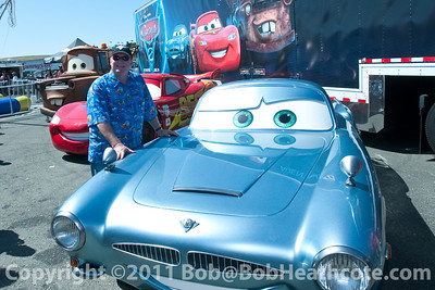 """Cars"" creator John Lasseter posing with his creations"