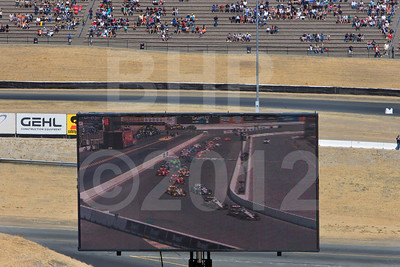 Race start viewed on the big screen for the fans in Turn 2 terrace seating
