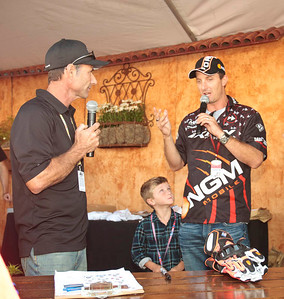 Colin Edwards with his son at the Riders for Health charity auction with presenter Rich Oliver