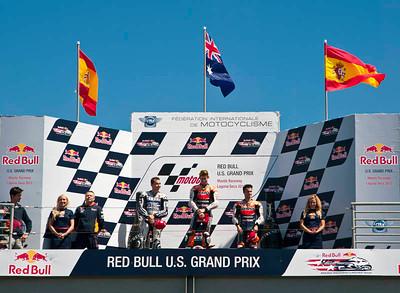 Post-race celebration for race winner Casey Stoner, with Dani Pedrosa and Jorge Lorenzo