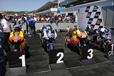 Top three prototype bikes in parc ferme after the race