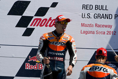 Post-race celebration for race winner Casey Stoner, with Dani Pedrosa and Jorge Lorenzo