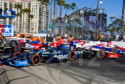Crash at hairpin with Rubens Barrichello, Justin Wilson; Helio Castroneves, James Jakes, Oriol Servia, and Ryan Briscoe
