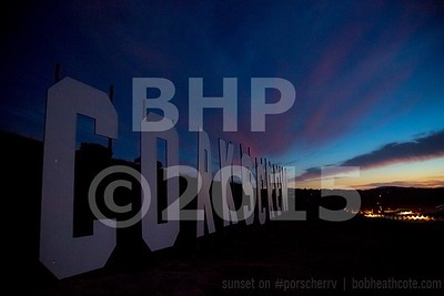 Corkscrew sign sunset