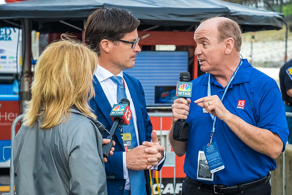 WTHR's Chuck Lofton talking to IMS President J. Douglas Boles along pit row before the 101st running of the Indy 500.