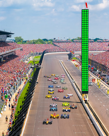James Hinchcliffe takes the green flag for the start of the 100th Running of the Indianapolis 500 mile race in front of an estimated 350,000 people.