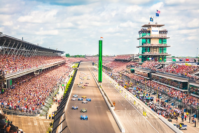 Scott Dixon leads the field of 33 into turn one at the Indianapolis Motor Speedway for the start of the 101st Indy 500.