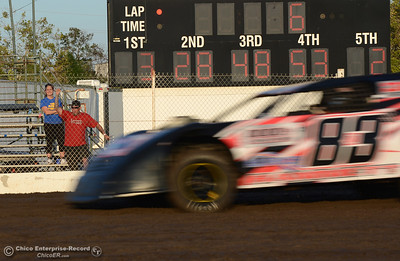 A fan cheers as Cameron Hammett (83JR) takes the second heat of street stocks racing Friday, Aug. 5, 2016, during Points Race No. 13 at the Silver Dollar Speedway in Chico, California. (Dan Reidel -- Enterprise-Record)