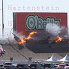 Lap 12 at the Las Vegas Indy 300 created a horrific crash that took the life of Dan Wheldon. Car #77 upside down at the left side of the O'Reilly billboard.